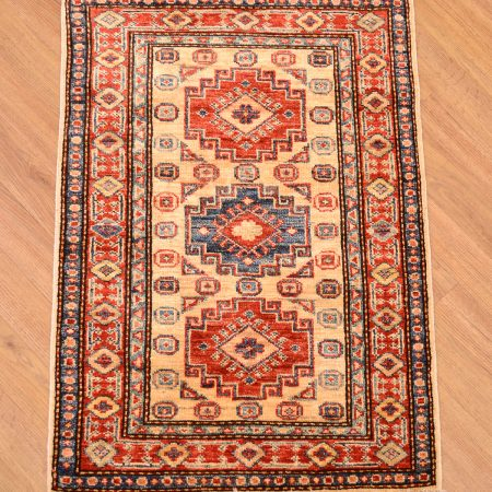 Handknotted Afghan Rug of Kazak design with beige background and 3 medallion pattern and rust border.