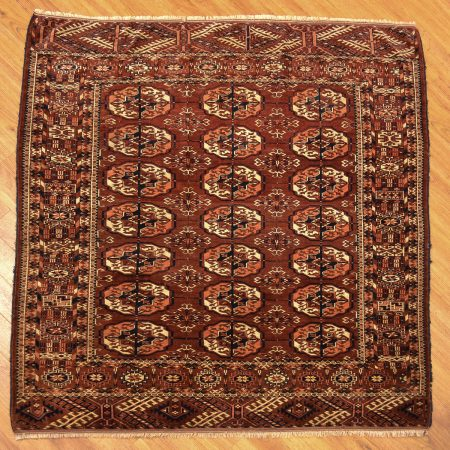 Fine quality antique brown Tekke square wedding rug consisting of 21 guls.