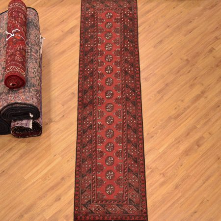 Narrow width red Afghan Aqcha Bokhara Runner with single row of Bokhara guls.