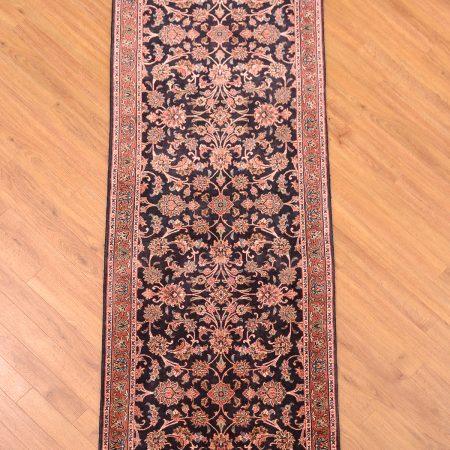 Fine handknotted high quality Persian Bidjar Part Silk Runner of all over floral design on a dark blue background.