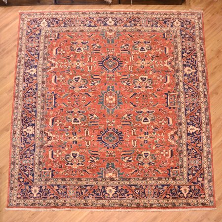 Stunning fine Afghan Aryana Carpet of all over floral pattern laid on a terracotta background surrounded by a blue main border.