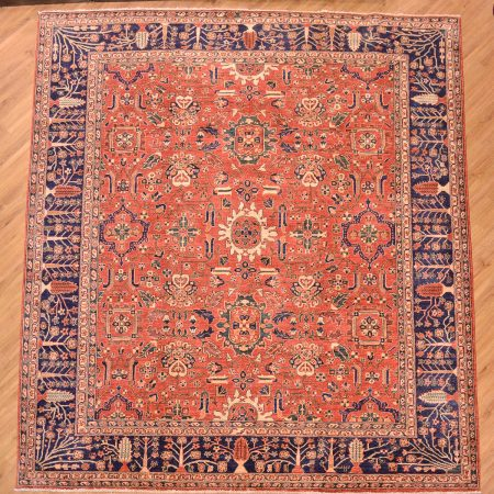 Beautiful fine Afghan Aryana Carpet of all over floral design on a terracotta background with delightful blue, tree motif border.
