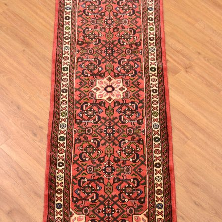 Classic handmade, handknotted Persian Hosseinabad Runner with medallion centrepiece and herati field arrangement on a terracotta background.