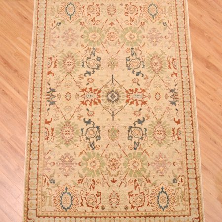 A newly made floral design Indian Jahan Rug hand-knotted with soft colours and a vintage look zero pile texture.