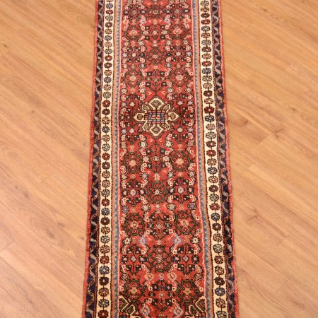 Extra narrow width handmade Persian Hamadan Runner with handknotted wool pile featuring a medallion design with herati field decoration on a terracotta background.