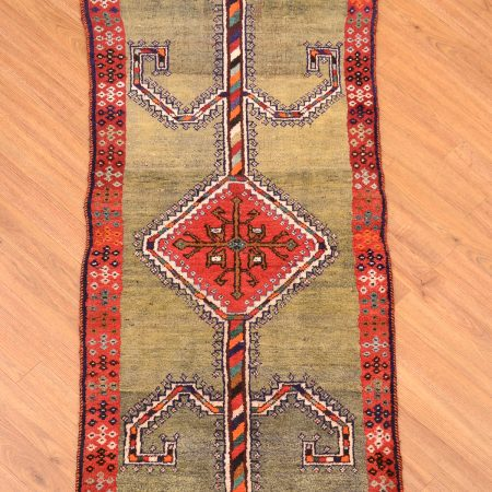 Unusual green ground old Persian Gabbeh Strip of medallion design handmade entirely from wool.
