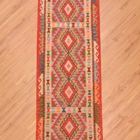 Handwoven flat weave Afghan Veg Dye Kilim Runner of vibrant multi-colours and geometric pattern.