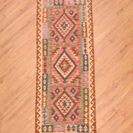 Handwoven flat weave Afghan Veg Dye Kilim Runner of 3 panelled medallions in soft colours including pink.
