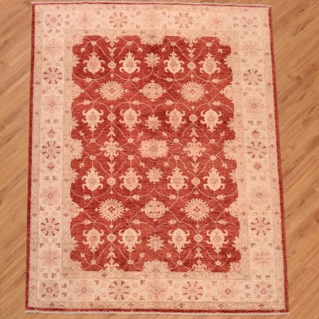 Afghan Ziegler Red Rug with beige borders and all over floral design.