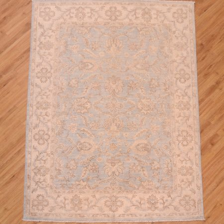 Hand-knotted Afghan Ziegler Rug of all over floral pattern with soft blue background and beige border.