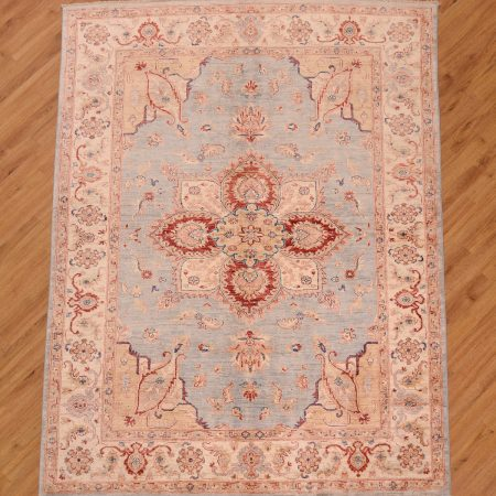 Handmade, handknotted Afghan Ziegler Heriz design Rug with light blue field and beige borders. It has a high gloss wool pile.