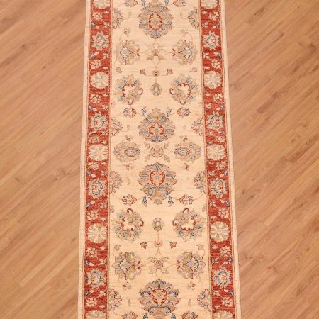 Cream ground with red border handmade Afghan Ziegler Runner with all over large scale floral pattern.