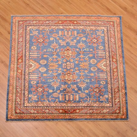 Handmade and hand-knotted blue ground fine Afghan Kazak Square Rug with all over geometric pattern.
