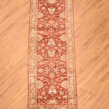 All over design floral handknotted Indian Agra Runner with terracotta background colour.