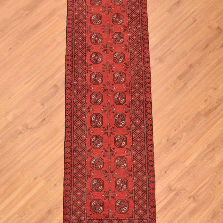 Traditional design Afghan Aqcha Bokhara Runner in a narrow width size.