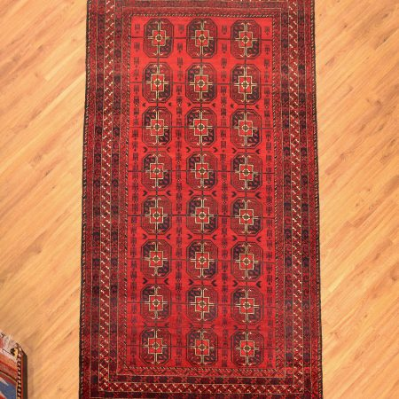 Red and black bokhara design handmade tribal Afghan Belouch Kelleghi Carpet made with a hand-knotted wool pile.
