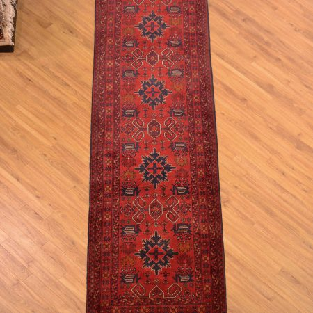 Hand-knotted Afghan Khan-Mohamadi Runner of traditional design and colouring slightly reminiscent of Perepedil rugs.