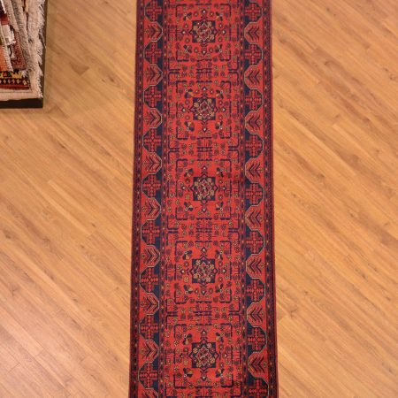 Handmade handknotted Afghan Khan-Mohamadi Runner of classic design and traditional orangey-red colour scheme.