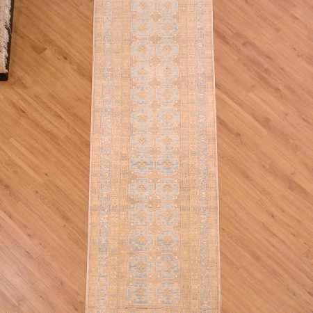 Hand-knotted Afghan Khotan Runner of all over geometric design with pale colours of blue, yellow and beige.