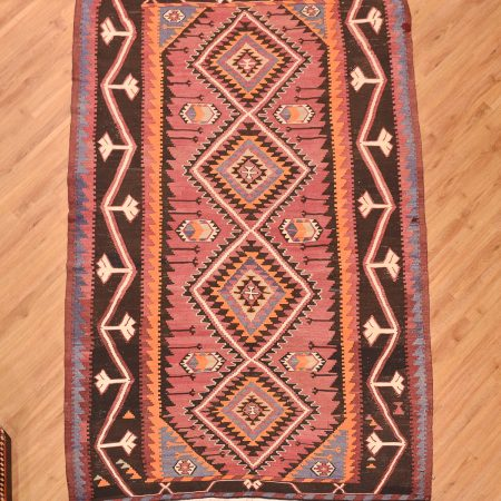 Hand-woven old Caucasian Kuba Kilim rug with 4 medallion geometric pattern. Wool woven onto cotton warps.
