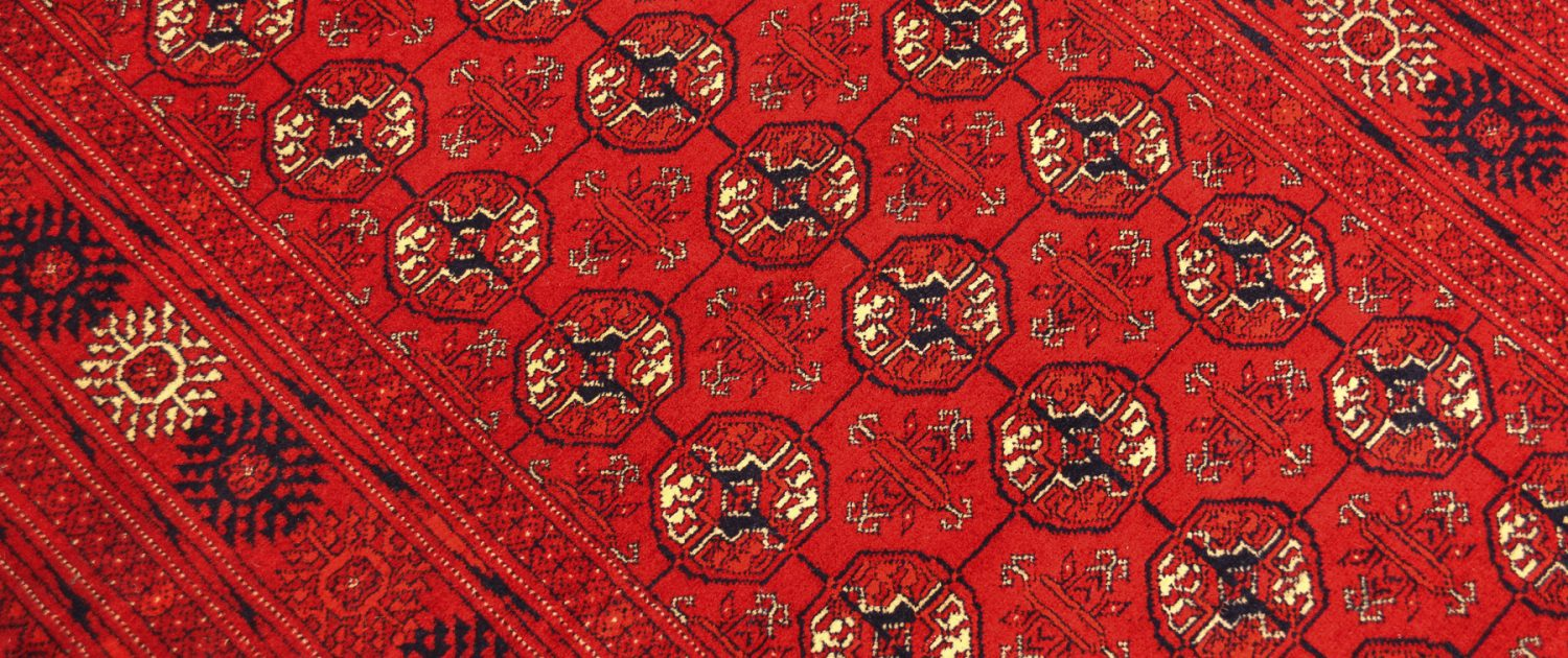 Top quality handmade hand-knotted fine Mauri Runner of bright red colour and Bokhara pattern.