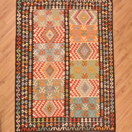 Hand-woven, handmade Afghan Veg-Dye Kilim Rug with black main border surround and panel design centre of 12 panels.