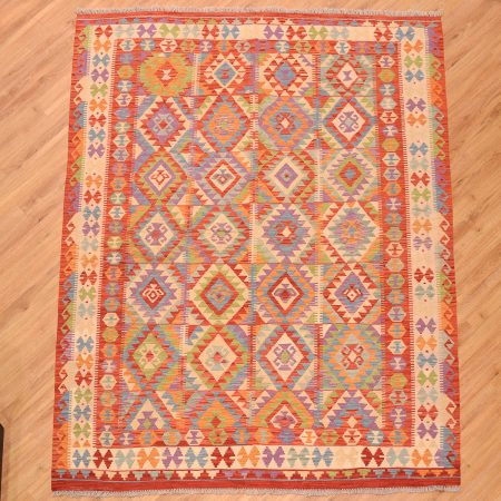 Hand-woven Afghan VegDye Kilim Rug with panelled all over design and multi-colours including purple.