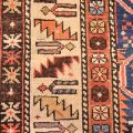 Early Twentieth Century antique Daghestan Rug of hand-knotted wool pile and superb all-over design of flowers in a lattice arrangement on a blue ground.
