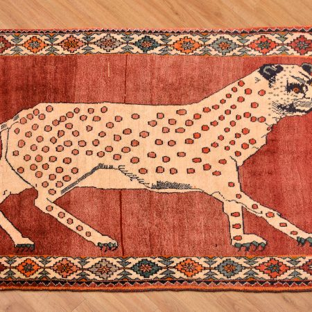 Handmade Pictorial Persian Leopard Gabbeh Rug with hand-knotted wool pile, the Leopard is set against a terracotta background.