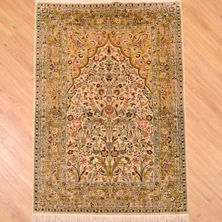 Intricately hand-knotted fine silk Hereke Mihrab Turkish rug with tree of life / mihrab design.