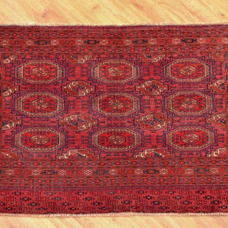 Rich red coloured red and indigo Turkoman Antique Tekke Chuval bag-face rug with 9 classic turret guls.