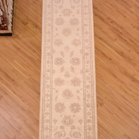 Handmade & hand-knotted Afghan Ziegler Runner beige with faint large scale floral decoration.