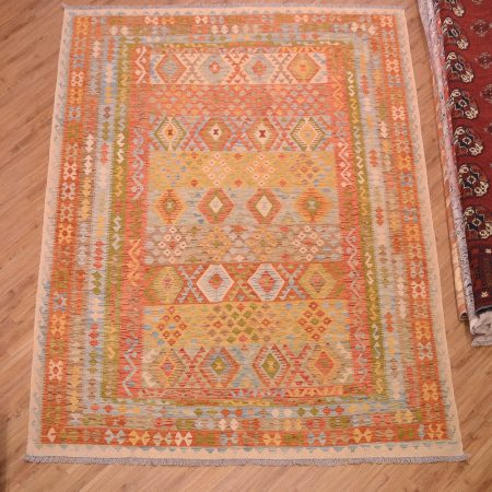 Handwoven Afghan Veg-Dye Kilim rug in a large size with soft colours including orange, yellow and blue.