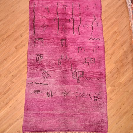 Purple Moroccan Berber Beni Mrirt Carpet with ancient tribal symbols. Handmade, wool pile hand-knotted onto wool.