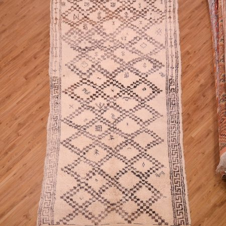 Tribal Moroccan Berber Beni-Ourain Carpet Kelleghi cream white with brown lattice pattern.