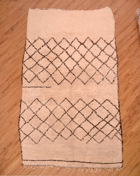 Shaggy pile, handmade Moroccan Berber Beni Ourain Carpet of creamy off white colour with dark brown lattice pattern.