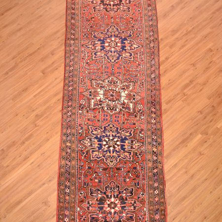 Beefy quality Persian Heriz-Ahar Runner with 5 slightly curvilinear medallions on a terracotta background.