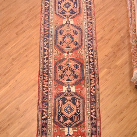 Chunky quality handmade, hand-knotted wool pile Persian Heriz Runner in wide width format with 4 medallions on a terracotta background.