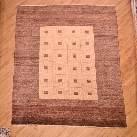 Handmade and hand-knotted Modern design Afghan Chubi Carpet with parqueted central design and wide brown plain border.