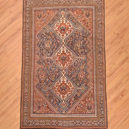 Stunning handmade hand-knotted all wool antique Persian Qashqai Rug with 3 medallion design against a light blue field with rust corners and brown main border.