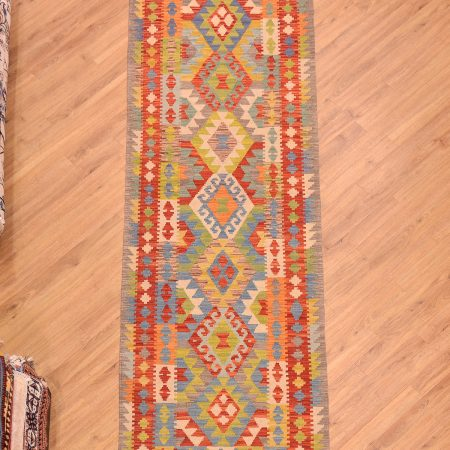 Jolly coloured handmade, hand woven Afghan Veg Dye Kilim Runner with bright multi-colour medallion design.
