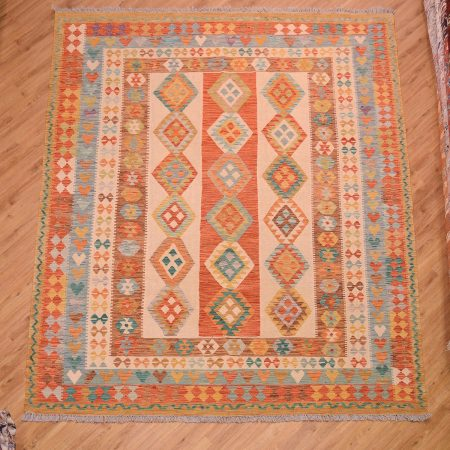 Handmade Afghan Veg-Dye Kilim / Kelim Rug with field of 3 stripes in beige and terracotta with geometric decoration.