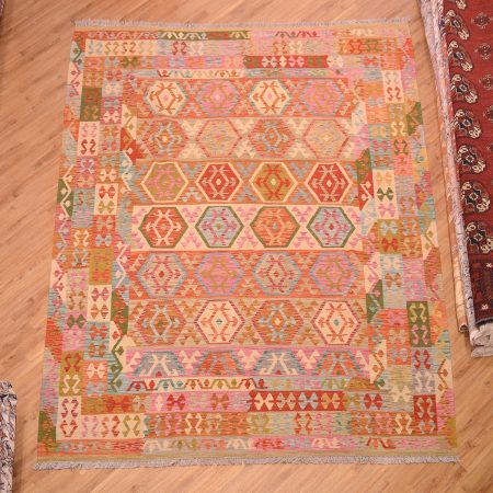 Great value hand woven handmade Large Veg Dye Afghan Kilim Rug of all over pattern with cheerful colours including pink, blue, green, olive and brown.