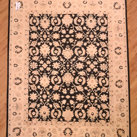 Handmade, hand-knotted Afghan Ziegler Black Carpet of all over floral pattern against a black background with gold patterning and beige main border.