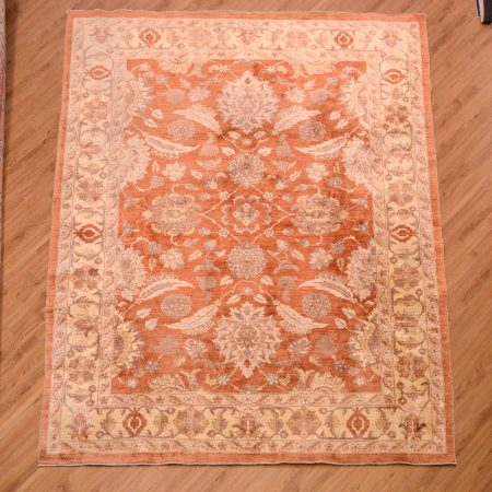 Great value Afghan second hand Ziegler Carpet with traditional all over floral pattern on a rust orange background surrounded by a gold main border.