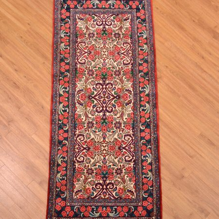 Fine handmade Persian Floral Bidjar Runner with cream background blue border with theme of roses.