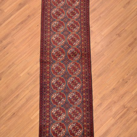 Afghan Narrow Khan Mohamadi Runner handmade with an unusual blue-green field and traditional all over repeating pattern of 20 Bokhara Guls.