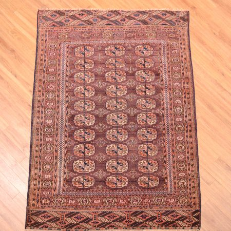 Traditional antique Tekke Rug dating from the late 19th Century with 30 guls on a brown field.