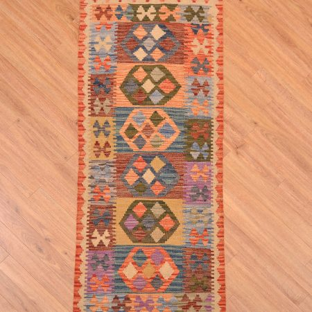 Great value handmade and hand-woven Veg Dye Afghan Kilim Strip with traditional colourful 8 medallion design each of which shows a different colour combination.