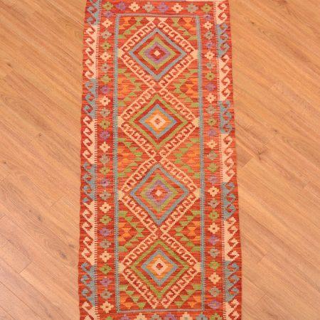 Handmade, hand-woven Veg-Dye Afghan Kilim Runner of 4 medallion design with main colour a tomato red / terracotta shade.